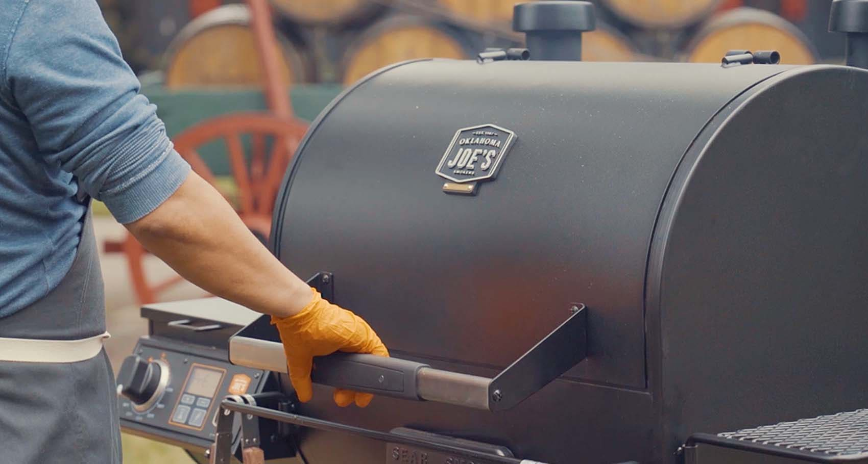 Chef Edward Lee smoking chicken wings in the Oklahoma Joe's® Rider DLX Pellet Grill