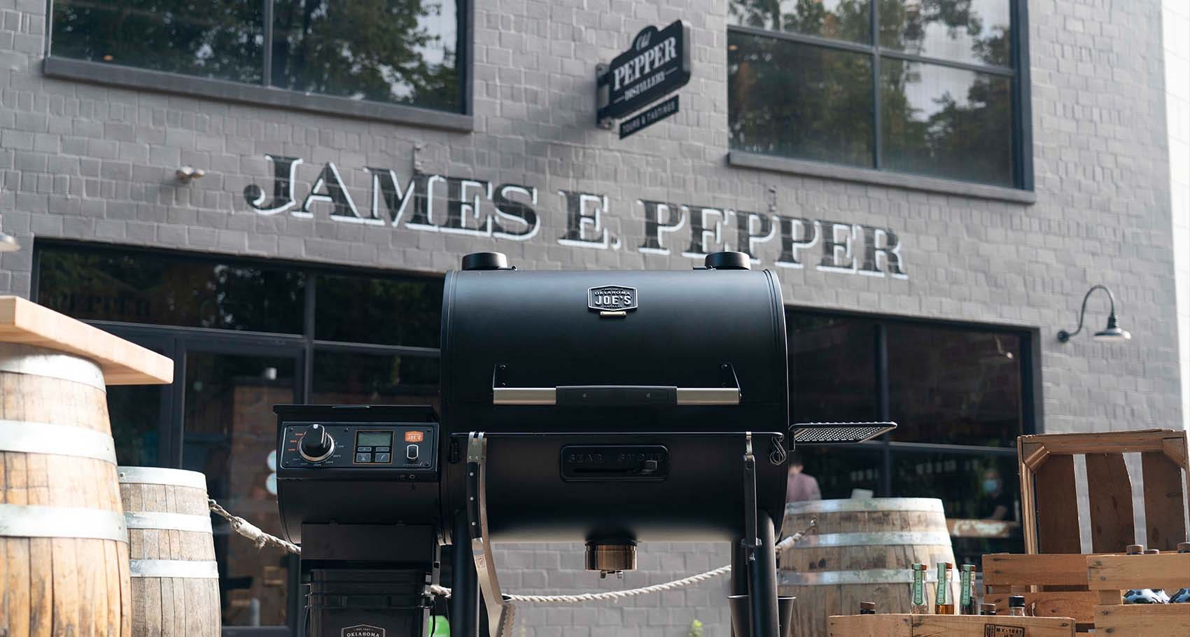 Chef Edward Lee cooking smoked chicken fried rice using the Oklahoma Joe's® Rider DLX Pellet Grill in front of the Old Pepper Distillery